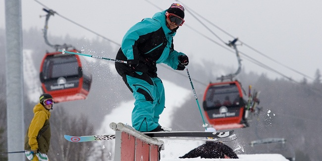 Skier under Chondola on rail